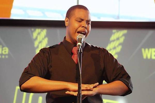 "Plainfield East High School senior Rapheal Mathis will head to Washington D.C. to compete at the national level of the ""Poetry Out Loud"" competition later this month. Mathis, shown here at a poetry slam in February, said he loves expressing himself through his own work and also reciting the work of others."