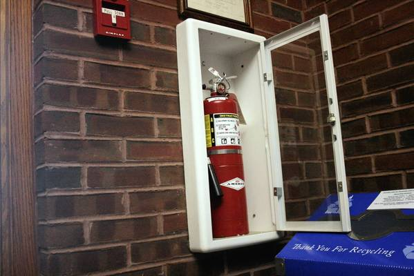 A fire extinguisher at the entrance of the Northbrook Village Hall.