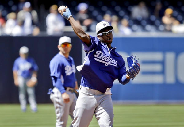Dodgers shortstop Hanley Ramirez throws during warm-ups before a game against the San Diego Padres.