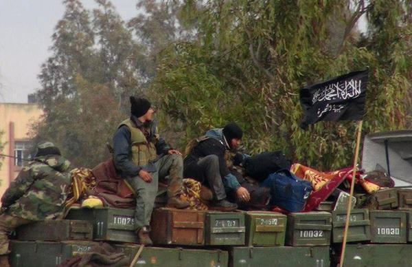 Fighters reported to be from the militant group Al Nusra Front are seen in a January photo said to be from Idlib province in northern Syria.