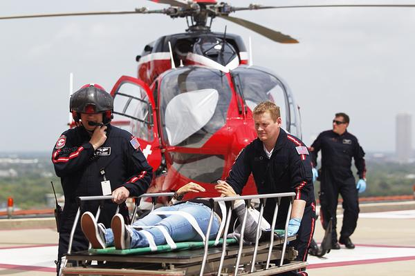 Life Flight personnel rush one of the stabbing victims into Memorial Hermann Hospital.