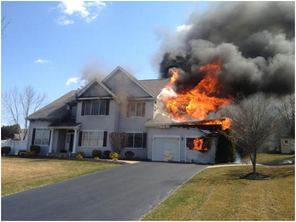 The fire  at 35 Centennial Drive in Milford  was reported just after 11 a.m., fire officials said. When they arrived on scene the garage was well-involved and the fire had spread to the home and attic space, officials said.