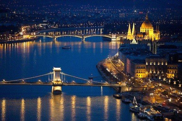 The lights of Budapest, Hungary, reflected in the Danube River.