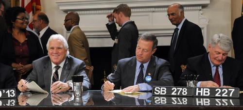 Left to right, Thomas V. Mike Miller, Jr., Senate President, smiles as Gov. Martin O'Malley and Michael E. Busch, House Speaker, sign SB 278 and HB 227 Maryland Employment Advancement Right Now (EARN) Program into law in the Governor's reception room.