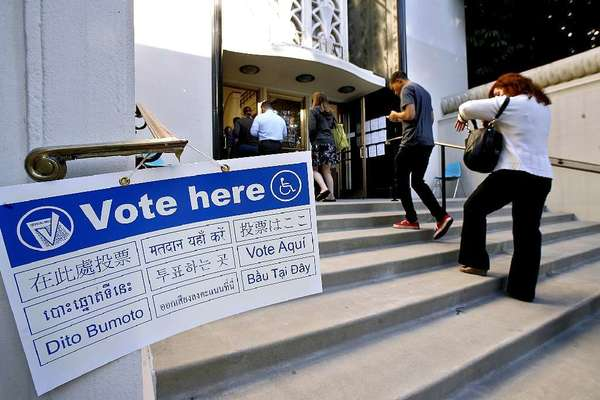 ARCHIVE PHOTO: Voters walk into Burbank City Hall to cast their ballots.