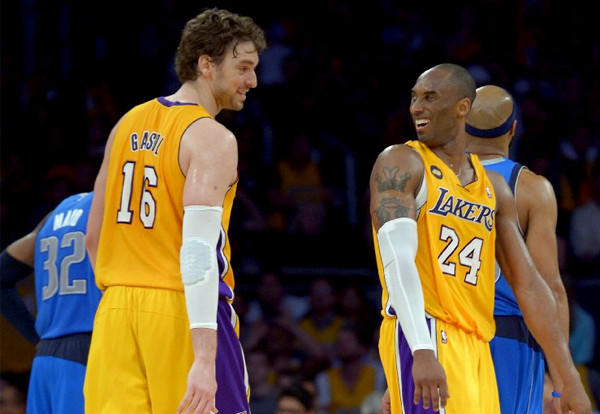 Pau Gasol and Kobe Bryant share a laugh after Bryant snagged a rebound to complete a triple-double against the Dallas Mavericks.