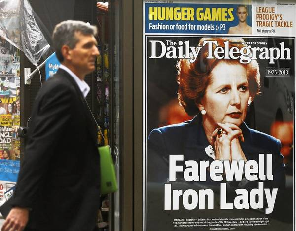 A man walks Tuesday past a Sydney newsstand bearing a newspaper portrait of former British Prime Minister Margaret Thatcher, who died Monday at 87.