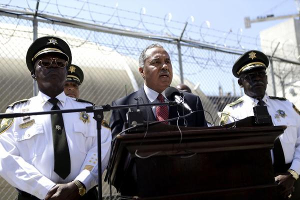 Orleans Parish Sheriff Marlin Gusman, center, is the target of criticism for poor conditions at the parish prison.