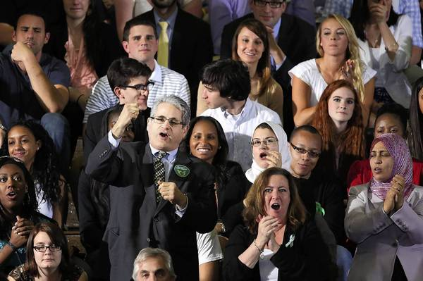 "Audience members chant ""we want a vote"" as U.S. President Barack Obama delivers a speech on gun control at the University of Hartford on April 8, 2013 in West Hartford, Connecticut. Nearly four months after the Sandy Hook Elementary School shootings, Connecticut has passed some of the toughest gun control measures in the nation."