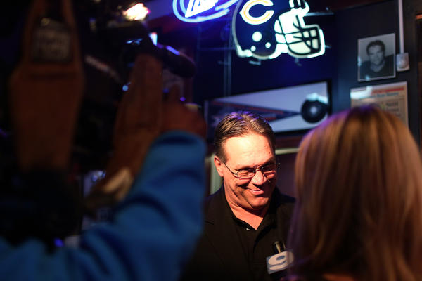 Former Chicago Bears player and Romeoville mayoral candidate Steve McMichael gives an interview to WGN News during an election party at Mongo McMichaels in Romeoville.