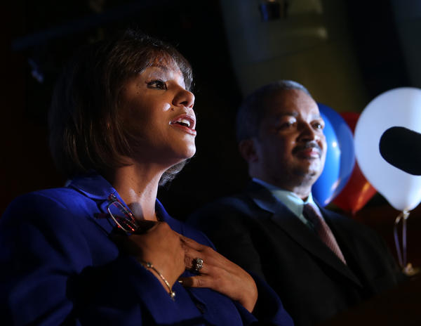 With her husband Nate Horn by her side, Robin Kelly gives a speech after being declared winner in the 2nd Congressional District race on election night in Matteson.