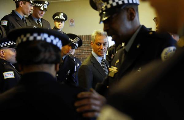Mayor Rahm Emanuel mingles with police recruits before speaking at their graduation ceremony Tuesday at Navy Pier, where he announced a new undercover initiative meant to crack down on drug dealing by West Side gangs.