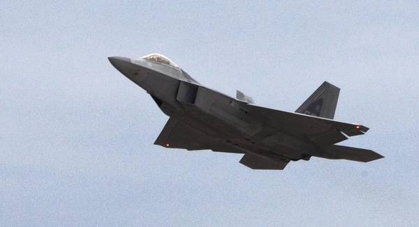 An F-22 takes off during a flight exercise at Langley Air Force Base in Hampton.