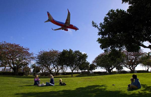 A plane prepares to land on the northermost runway at Los Angeles International Airport near Sepulveda Boulevard. Area residents oppose a plan to move the runway closer to residential neighborhoods.