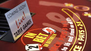 The state's largest casino plans to open 122 table games to the public at 12:01 a.m. Thursday.