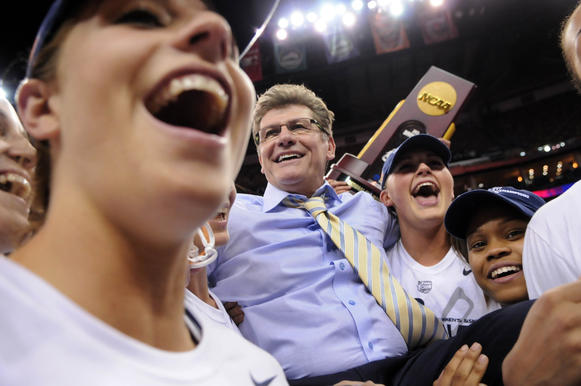 UConn coach Geno Auriemma is carried across the floor after the Huskies won the NCAA Division I women's championship at the New Orleans Arena Tuesday. UConn won, 93-60.