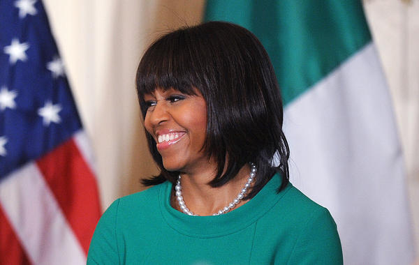 First lady Michelle Obama smiles during a reception for Ireland's prime minister in the East Room of the White House on March 19.