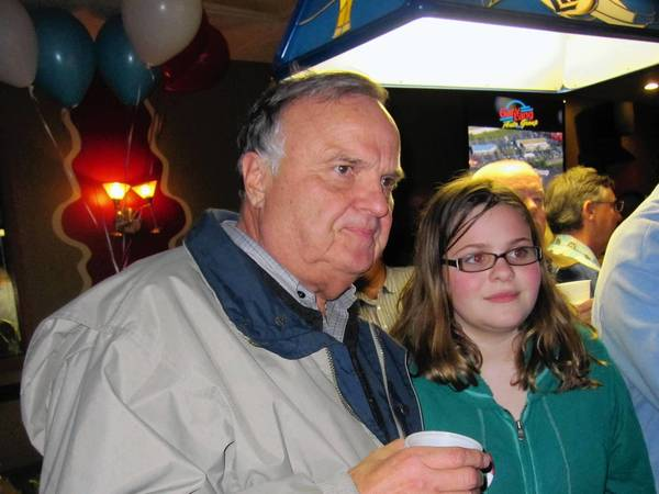 Tinley Park Mayor Ed Zabrocki, left, watches the early returns with granddaughter Emily, 13. Zabrocki held his election party at Bailey's.