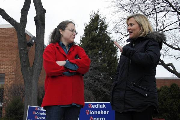 Northbrook/Glenview School District 30 candidate Ursula Sedlak, right, talks to Northbrook resident Lise Schleicher outside of an election location at Wescott School on April 9.