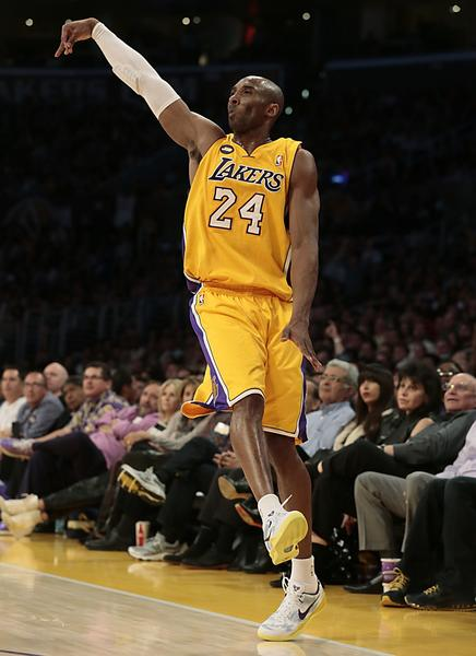 Kobe Bryant follows through as he hits a three-pointer late in the game against the New Orleans Hornets.