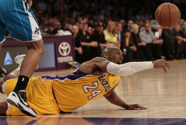 Lakers guard Kobe Bryant loses control of the ball as he slips in the second half.