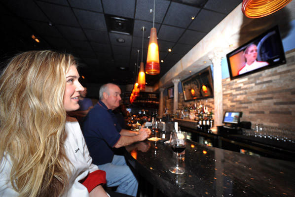 Jessica Lewis watches herself on Hell's Kitchen at a viewing party at Allentown's Roma Ristorante Tuesday. Jessica Lewis is a former Allentown resident, Parkland High graduate and now lives in Brooklyn, New York.