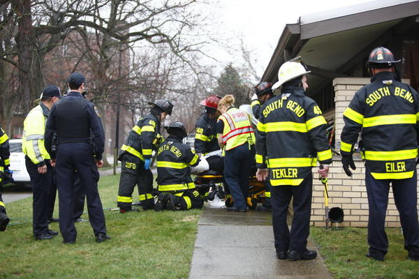 South Bend Tribune/SANTIAGO FLORES Emergency personnel work on transporting an accident victim after a car crashed through a law office on West Washington St. in South Bend.