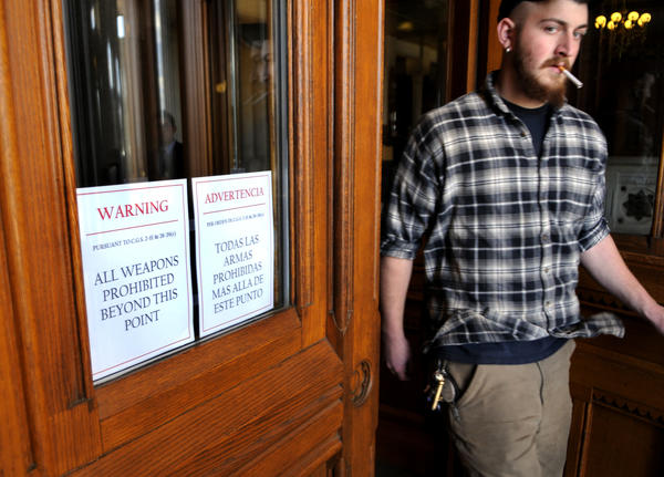 Kylie Foryan of Unionville, a welder for PTR, a gun manufacturer in Bristol, walks out of the State Capitol where he and a group from the company were showing their opposition to the proposed gun control legislation.