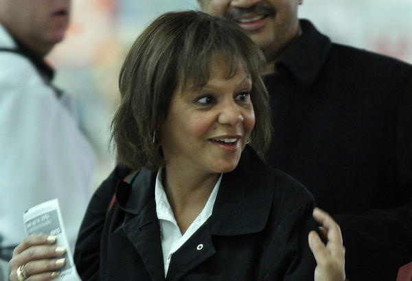 U.S. Representative-elect Robin Kelly, center, gets an escort through security to get to her flight for Washington, D.C., on Wednesday.