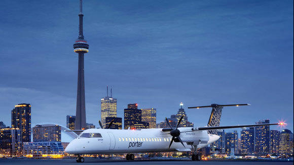 A Porter Airlines turboprop plane sits on the tarmac of Toronto City Airport.
