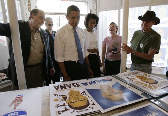 David Alexrod, left, Barack and Michelle Obama