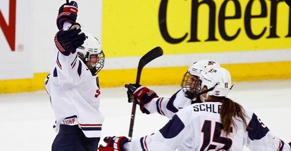 Megan Bozek of the U.S. celebrates her goal during their gold-medal game against Canada at hockey world championship.
