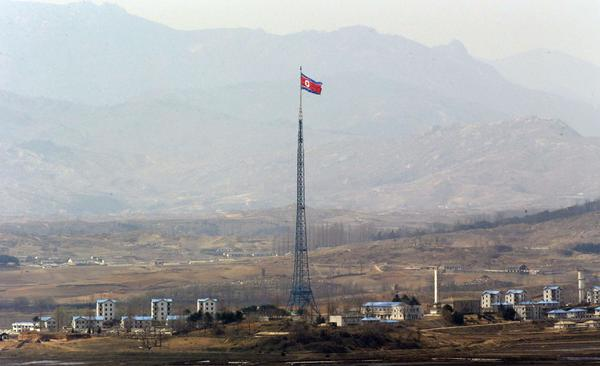 A North Korean flag is seen atop a 533-foot-tall tower in the village of Gijungdong, near the north side of the border village of Panmunjom.