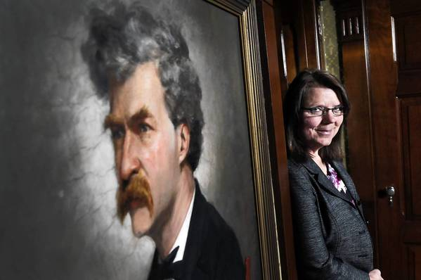 Cindy Lovell, the new director of the Mark Twain House and Museum in Hartford, stands on the third floor outside the billiard room of the famous house. Her old job was as director of the Mark Twain Boyhood Home in Hannibal, Missouri.