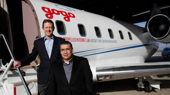 Gogo President and CEO Michael Small, left, and executive vice president and chief marketing officer Ash ElDifrawi are photographed before a demonstration of Gogo's faster speed internet technology at the Aurora Municipal Airport in November.