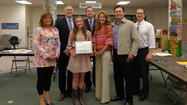 The Frankfort School District 157-C Board of Education recognized Hickory Creek Middle School eighth grade student Julia Chillon at its April 8 meeting. Julia was selected by the Illinois Elementary School Association (IESA) as a 2013 Scholar Attitude winner. The program supports the values of sportsmanship, ethics and integrity. Only one student from each of the fifteen membership divisions of the IESA was chosen by a panel of judges to be honored.