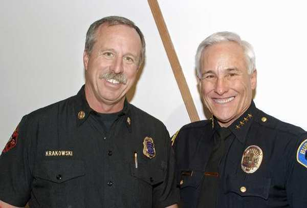 Fire Chief Ray Krakowski, left, and Police Chief Scott LaChasse at an event at Cartoon Network Studios in Burbank.