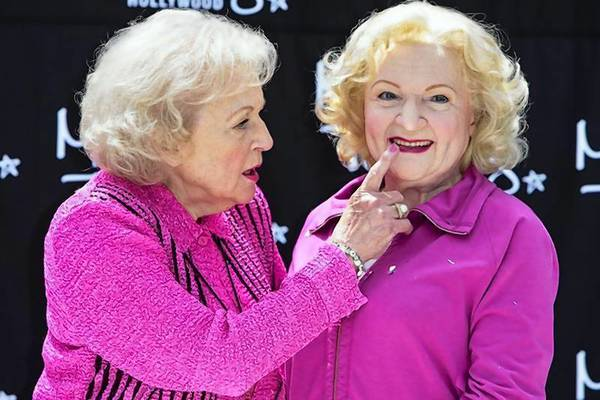 Betty White touches the lips of her wax figure during the unveiling at Madame Tussauds Hollywood wax museum in Los Angeles, Calif.