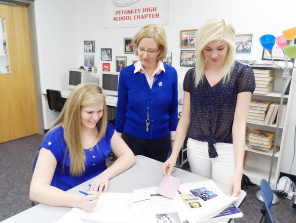 Petoskey High School student Anna Jakeway (left) and Charlee Hall (right) review their final skit with teacher Barbara Kennedy. The students will compete in the State Leadership Conference in Midland on April 17-19.
