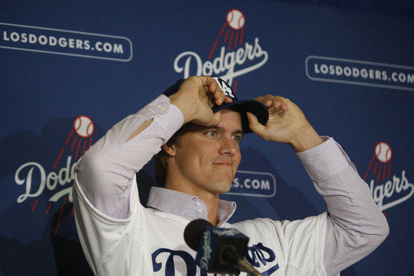 New Los Angeles Dodgers pitcher Zack Greinke adjusts his baseball cap at a press conference announcing his signing in December.