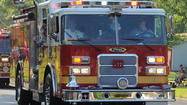 A three-alarm fire heavily damaged two attached homes and lightly damaged a third in Annapolis on Wednesday, displacing three families, according to the Anne Arundel County Fire Department.