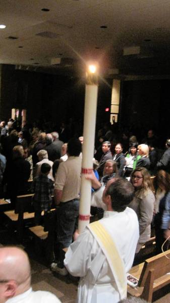 Worshippers gathered for Easter Vigil at Saint Michael Catholic Church in Orland Park.