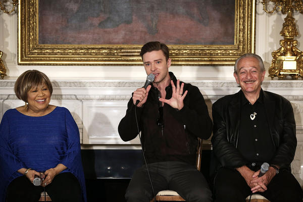 "Justin Timberlake, center, speaks as Mavis Staples and Charlie Musselwhite listen during an interactive student workshop, ""Soulsville, USA: The History of Memphis Soul,"" at the White House in Washington, D.C., on April 9, 2013."