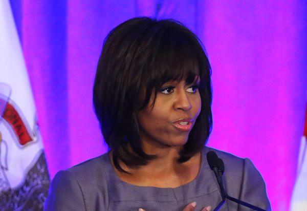 First lady Michelle Obama speaks at a luncheon at The Chicago Hilton while visiting Chicago for a discussion with Mayor Rahm Emanuel and civic leaders on ways to combat youth violence. She will also make a stop afterward at Harper High School, where students and alumni have been hit hard by gun violence.