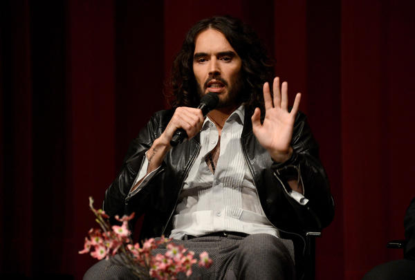 """'Swatting,' I dont like the word very much,"" Russell Brand says. ""Swatting, obviously what you do to insects or a passing bottom."""