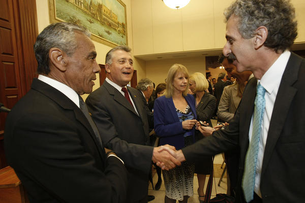 L.A. City Atty. Carmen Trutanich, second from left, shakes hands with challenger Mike Feuer before a debate.