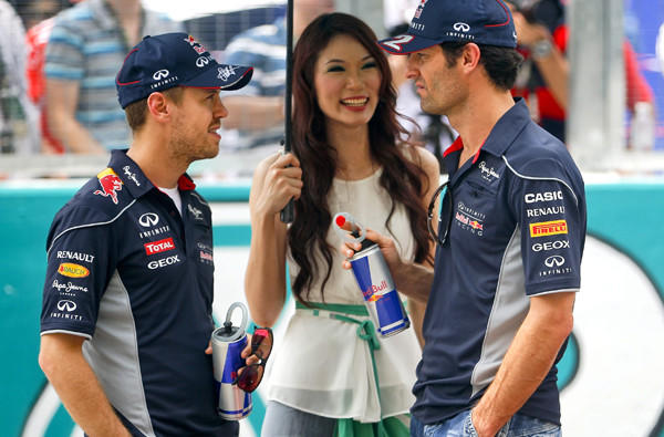 Formula One drivers Sebastian Vettel, left, and Mark Webber during the introductions before the start of the Malaysia Grand Prix last month.