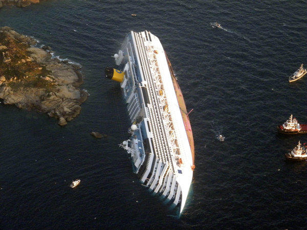 In this Jan. 14, 2012, photo provided by the Guardia di Finanza (border police), the cruise ship Costa Concordia rests on its side off the island of Giglio, Italy.