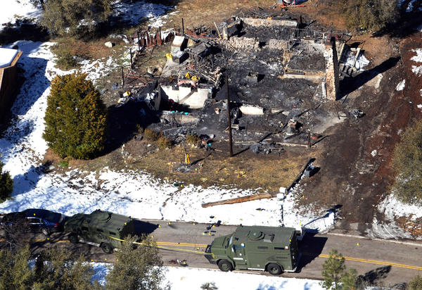 An aerial view of a burned-out cabin where accused murder suspect Christopher Dorner died after barricading himself inside.
