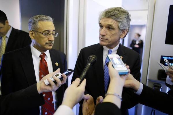 "Rep. Scott Rigell, R-Va., right, seen with Rep. Bobby Scott in February, said of the contractor's detention: ""Justice has not yet been served. Those who unlawfully detained him need to be held accountable, especially given that this occurred at the hands of those who are supposed to be our ally."""